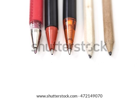 Many pens and pencils close up on a white background