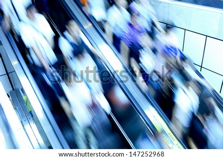 many people by Escalator in business city - stock photo