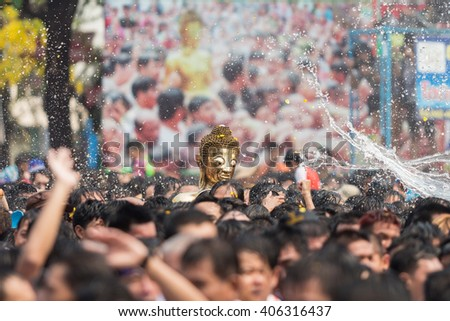 Many people have raised the Buddha statues to pray closely. On the Songkran Festival Nonghkai Thailand.