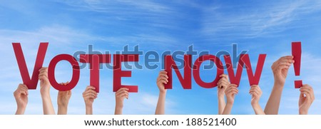 Many People Holding the Red Words Vote Now in the Sky - stock photo
