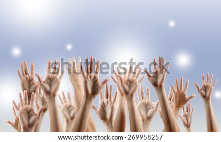 Many people's hands up. Copy space.