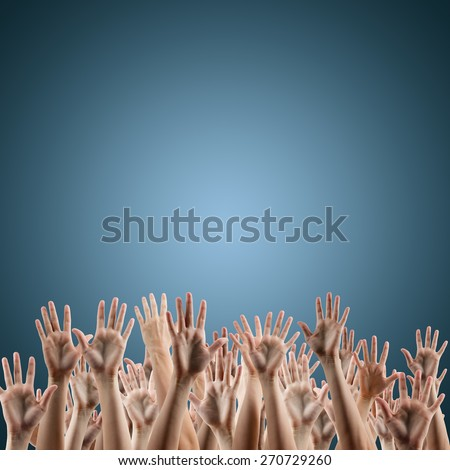 Many people's hands up isolated on blue gradient background. Various hands lifted up in the air. Clipping path. Copy space.