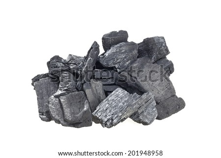 many pieces of charcoal isolated on white background - stock photo