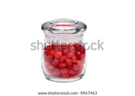 Many pieces of red cinnamon candy in a small jar isolated on a white background great for use alone or in composites.