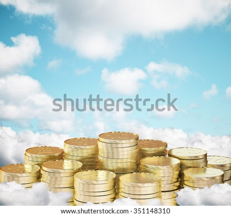 Many piles of coins on clouds with blue sky background - stock photo