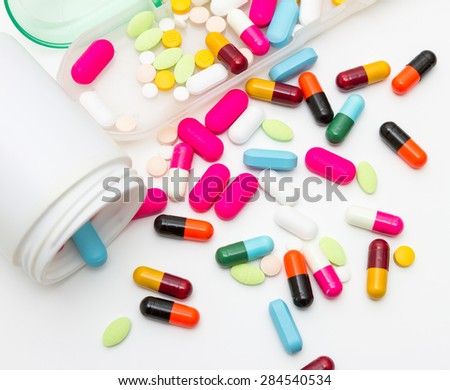 Many pills and tablets on white isolate background for decorate and design project.