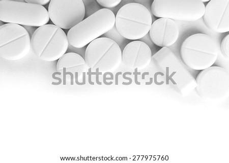 Many pills isolated on white - stock photo