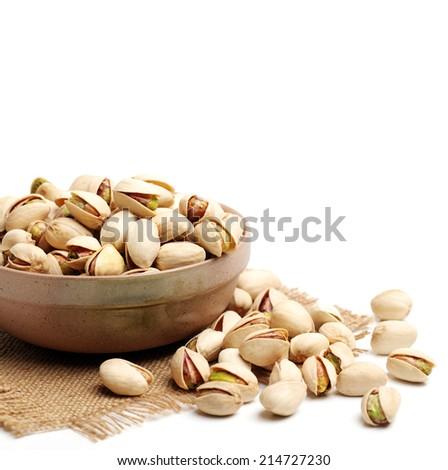 Many pistachio on white background  - stock photo