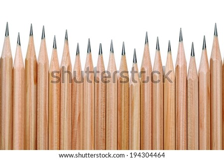 Many plain, wooden, sharpened pencils in a row. - stock photo