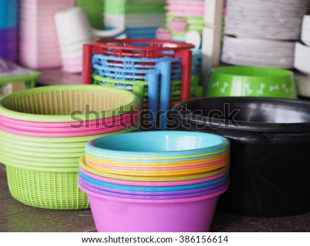 many plastic basins in different colors, as a stack on a open market, thailand