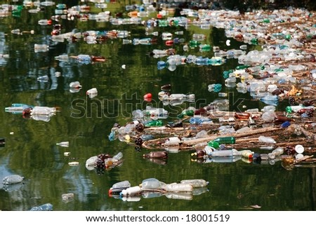 many plastic bottle on lake water - stock photo
