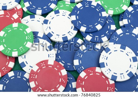 many poker chips on the green table