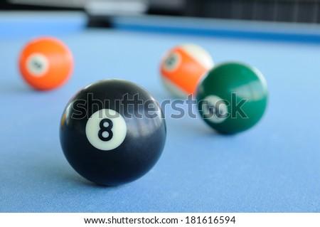 Many pool-balls on woolen fabric - stock photo
