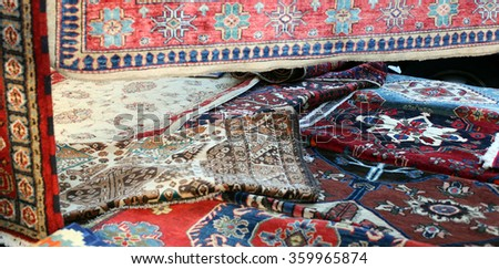 many precious ancient colored wool rugs made by hand in the Middle East