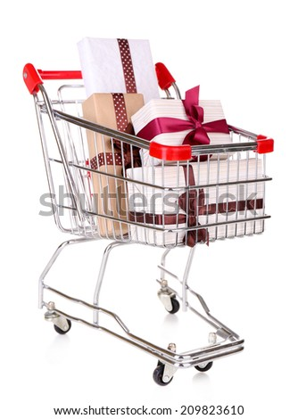 Many present boxes in shopping cart isolated on white
