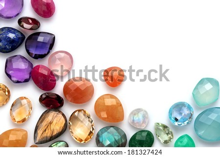 Many real colorful gemstones on the white background. Mix of many different shapes and kinds. - stock photo
