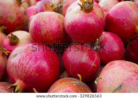 Many red delicious pomegranate fruits â?? close view