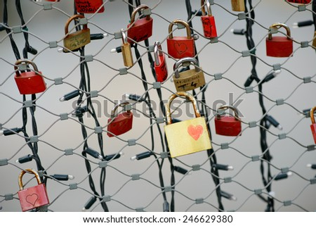 Many red locks and one gold lock with a drawn heart