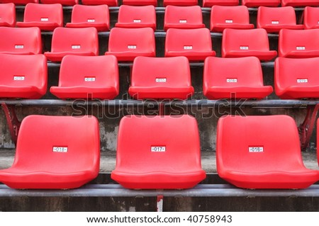 many red seats in a stadium - stock photo