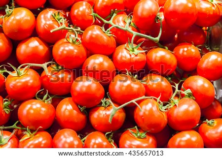 Many red tomatoes at the farm market