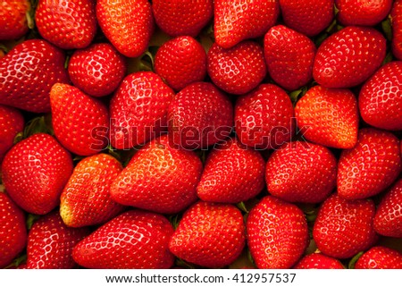 Many ripe strawberries as fruit background picture