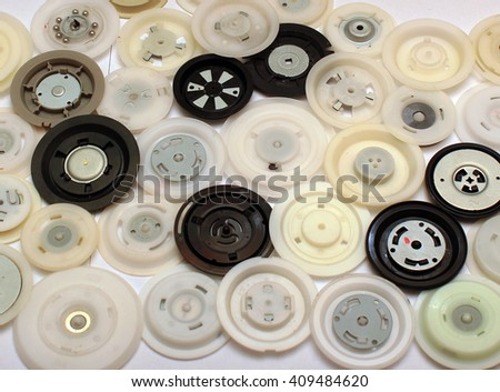 Many round plastic clamps from cd and dvd disc drives