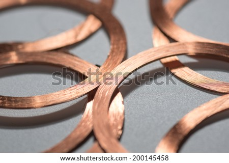 many round RFID Antenna copper coil gray Background - stock photo