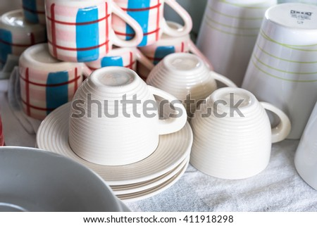 many rows of coffee or tea cups for background - stock photo
