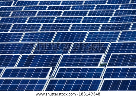 Many rows of large solar panels in a power plant - stock photo