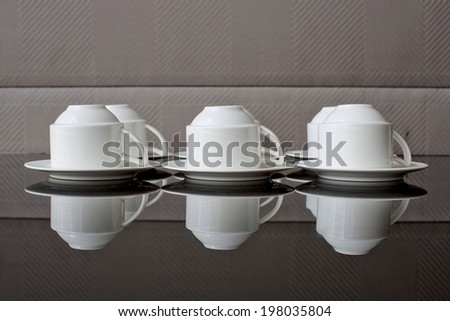 Many rows of pure white cup and saucer