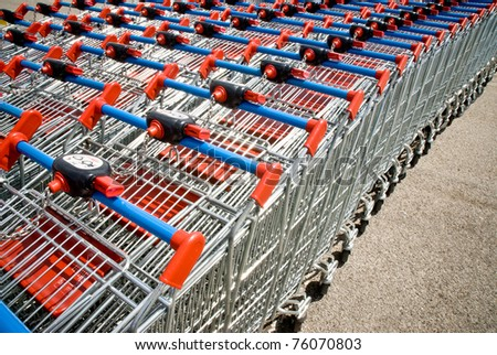 many rows of shopping trolley - stock photo