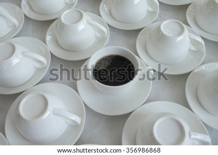 Many rows of white ceramic coffee or tea cups.close up of a white cup on white background - stock photo