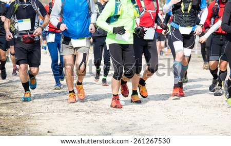 many runners run in the outdoor race on the road - stock photo