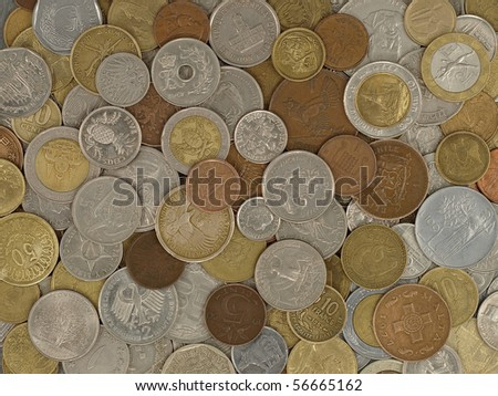 Many scattered coins of different countries and times.Background. - stock photo