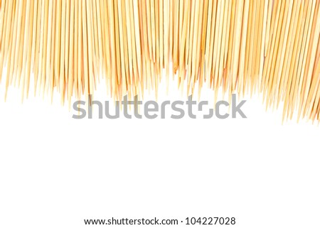 Many scattered toothpicks isolated on white - stock photo