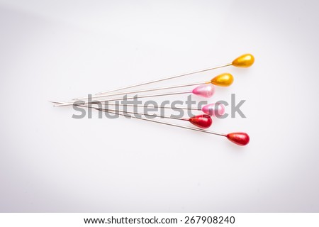 Many sewing push pins isolated on white background. with clipping path - stock photo