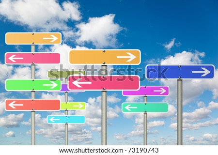 many signs with arrow on White, fluffy clouds in blue sky collage - stock photo
