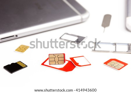 many sim card, sim card adapter, sim card eject tool and digital media micro sd card and smart phone put on white background - stock photo