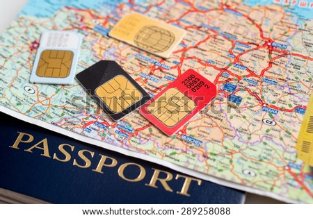 many sim cards with the europe map on background of a passport - stock photo