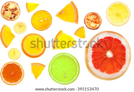 Many slices of citrus. Oranges, lemons, limes, grapefruit and pomegranates. Isolated fruit pieces on a white background. Limon slices top view. - stock photo