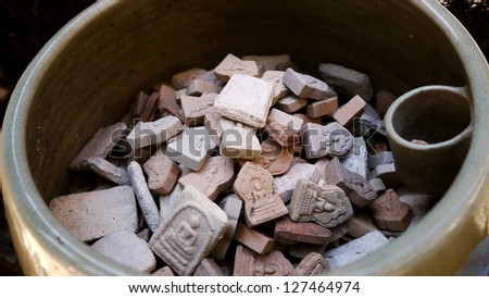 Many Small Buddha Image or Votive Tablets. - stock photo
