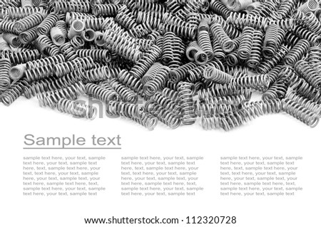many small chrome springs isolated on white - stock photo