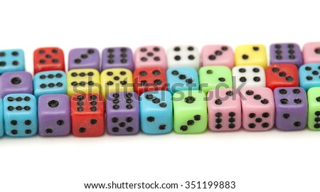 many small colorful plastic  dice isolated on white background