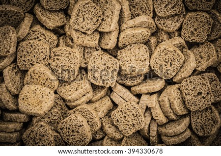 Many small dried rusks bread loaf toast biscuits as texture background. Diet food healthy nutrition. - stock photo