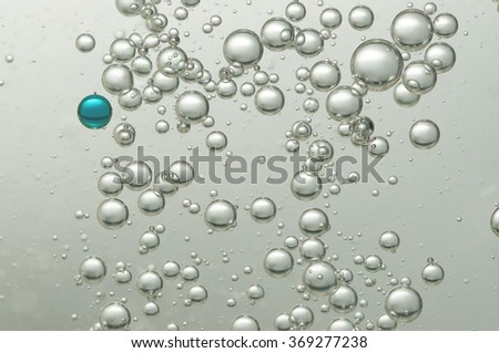 Many small oxygen bubbles floating in water - stock photo