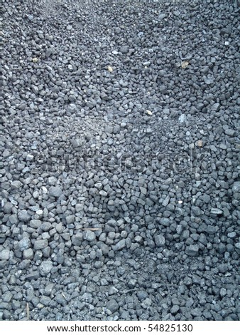 Many small pieces of coal used to power a train.  The pattern made by the coal makes a cool background. - stock photo