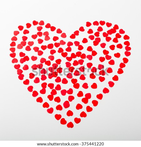 Many small red hearts like big red heart on white background