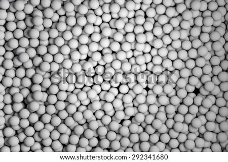 Many small white balls randomly arranged. 3d render image. - stock photo