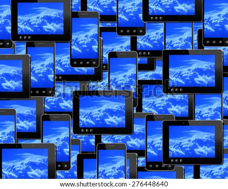 many smart-phones and tablets with image of blue sky - stock photo
