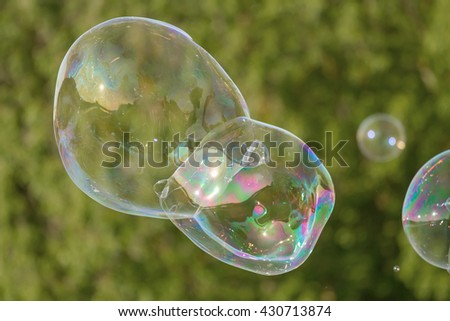 Many soap bubbles in park